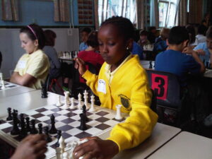 girl at junior chess tournament